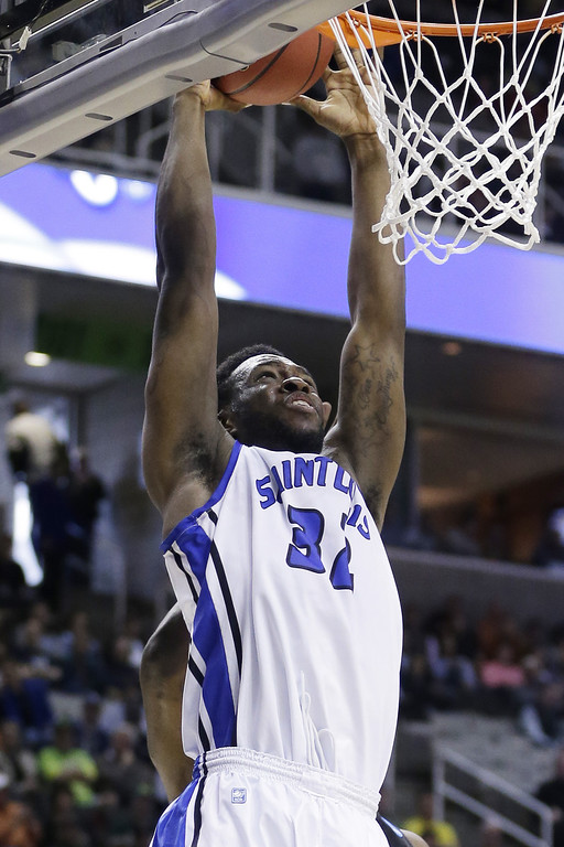 . Cory Remekun #32 of the Saint Louis Billikens dunks against the New Mexico State Aggies in the second half during the second round of the 2013 NCAA Men\'s Basketball Tournament at HP Pavilion on March 21, 2013 in San Jose, California.  (Photo by Ezra Shaw/Getty Images)