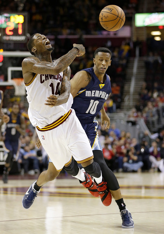 . Memphis Grizzlies\' Troy Williams (10) fouls Cleveland Cavaliers\' DeAndre Liggins (14) in the second half of an NBA basketball game, Tuesday, Dec. 13, 2016, in Cleveland. The Cavaliers won 103-86. (AP Photo/Tony Dejak)