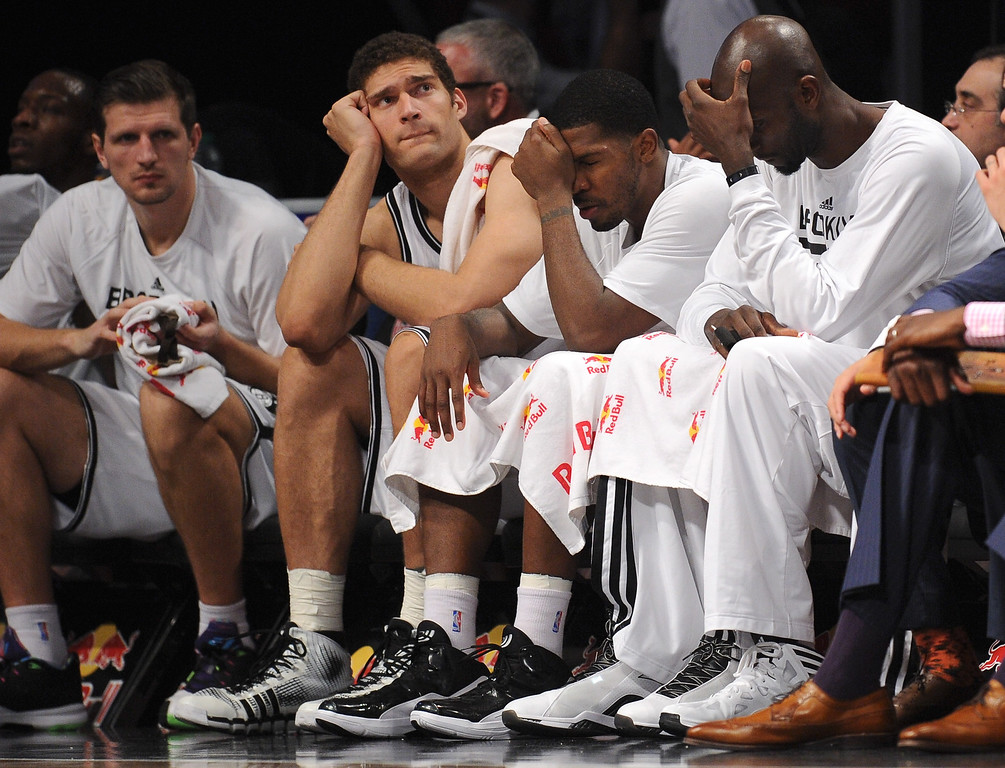 . NEW YORK, NY - DECEMBER 03:  Mirza Teletovic #33, Brook Lopez #11, Joe Johnson #7 and Kevin Garnett #2 of the Brooklyn Nets sit on the bench during the fourth quarter against the Denver Nuggets at Barclays Center on December 3, 2013 in the Brooklyn borough of New York City. (Photo by Maddie Meyer/Getty Images)