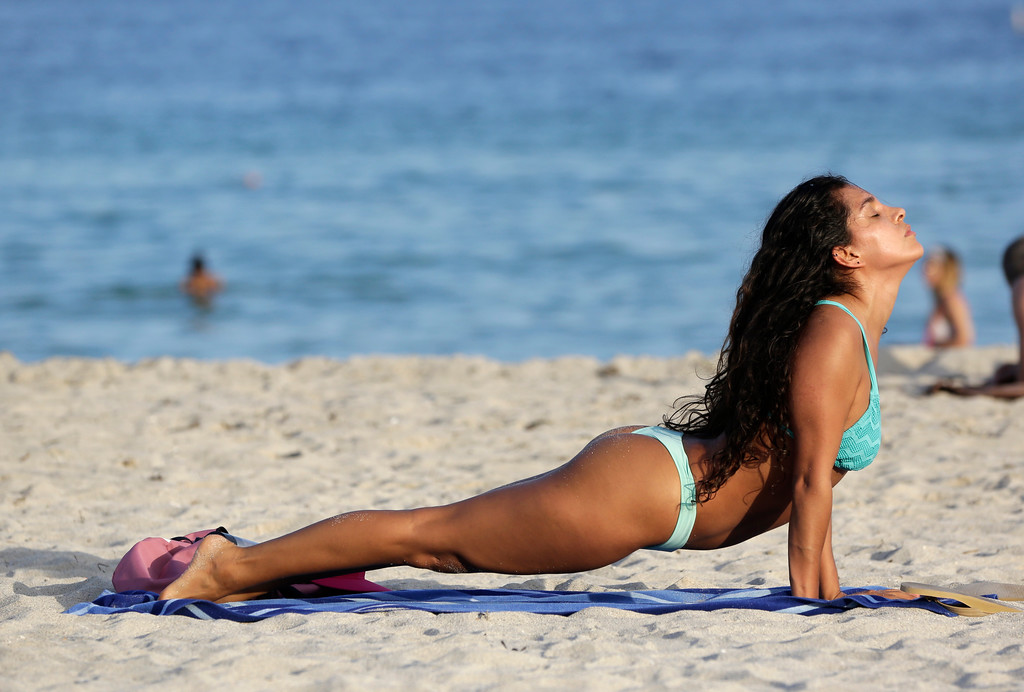 . Giselle Lopez, of Miami Beach, Fla. exercises on the beach, Wednesday, Dec. 14, 2016, in Miami Beach, Fla. Temperatures are above average and in the mid-80\'s in South Florida as an arctic cold front moves from the Plains to the Ohio and Tennessee Valleys, and towards the mid-Atlantic and Northeast by Thursday. (AP Photo/Lynne Sladky)