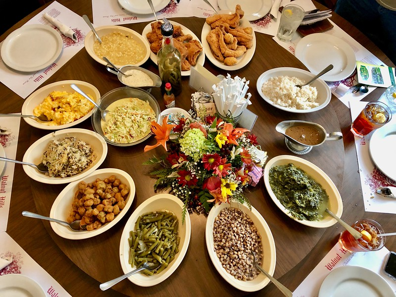 Southern food dishes spread out on a lazy susan at Walnut Hill Restaurant.