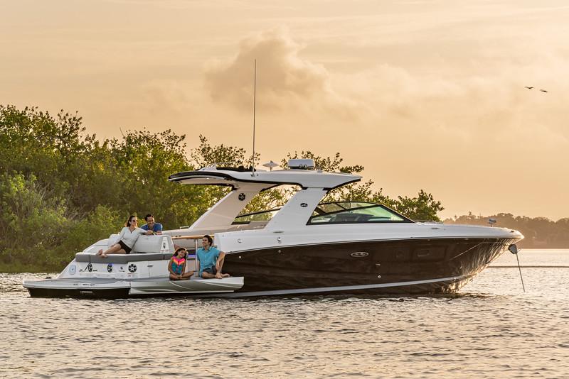 2021-SLX-400-SLX400-lifestyle-starboard-stern-three-quarter-family-swim-terrace-04572.jpg