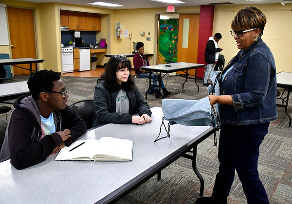 2/1/2020 Mike Orazzi | Staff URISE Ventures's Alice Turner talks with Lolade Phillips and Isabella Testanero during a Youth Entrepreneurship workshop at the New Britain Public Library on Saturday afternoon.