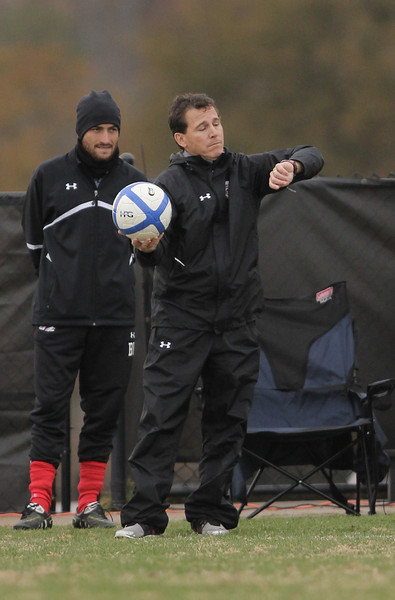 Head Coach Setzer checks his watch waiting for the LU player to throw in the ball.