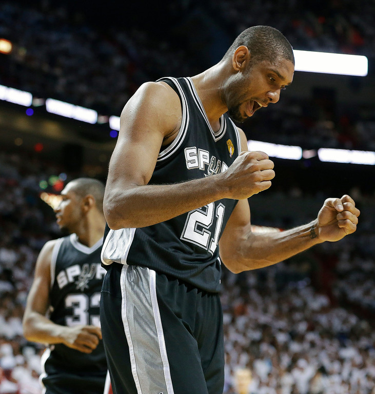 . San Antonio Spurs forward Tim Duncan (21) reacts to play against the Miami Heat during the second half of Game 6 in their NBA Finals basketball series, Tuesday, June 18, 2013 in Miami. (AP Photo/Lynne Sladky)