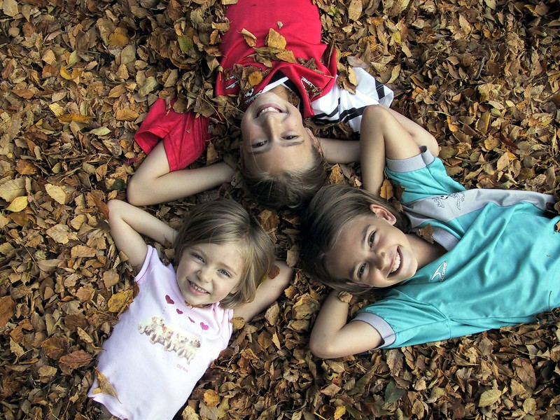 girls in leaves triangle2 10-03.JPG