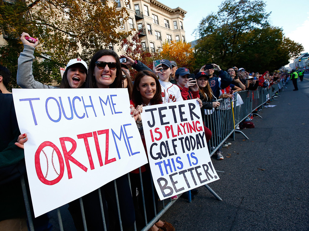 . BOSTON, MA - NOVEMBER 02: Fans hold up signs during the World Series victory parade on November 2, 2013 in Boston, Massachusetts.  (Photo by Jared Wickerham/Getty Images)
