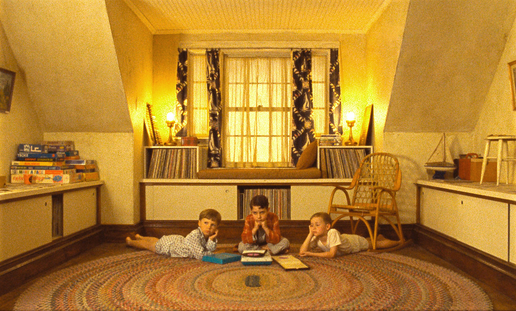 """. The children\'s attic playroom in \""""Moonrise Kingdom\"""" features a rag rug, vintage fabric curtains and a color palette straight out of the \'50s. (Focus Features)"""