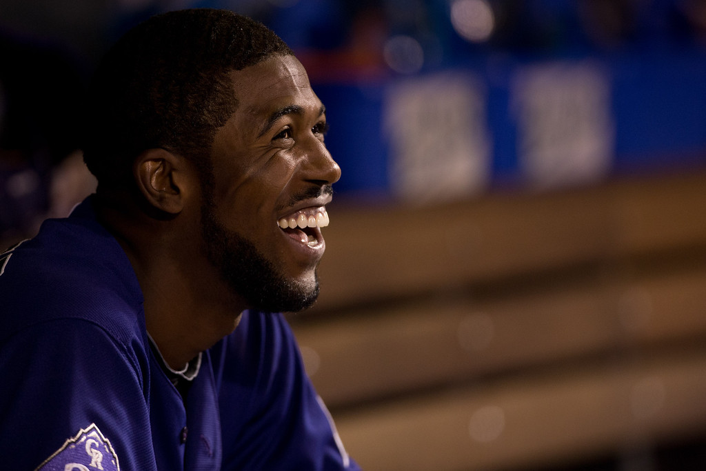 . DENVER, CO - JULY 20:  Dexter Fowler #24 of the Colorado Rockies smiles in the dugout after scoring in the eighth inning against the Chicago Cubs at Coors Field on July 20, 2013 in Denver, Colorado.  The Rockies defeated the Cubs 9-3.  (Photo by Justin Edmonds/Getty Images)