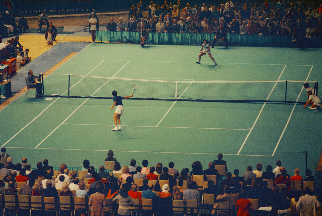 """. Tennis star Bobby Riggs, bottom, and Billie Jean King are shown in action during the \""""Battle of the Sexes\"""" match in the Astrodome in Houston, Tex., Sept. 20, 1973.  (AP Photo)"""