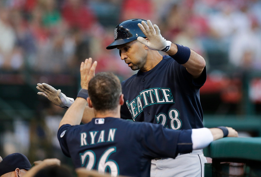 . Seattle Mariners\' Raul Ibanez celebrates his home run with teammates during the second inning of a baseball game against the Los Angeles Angels in Anaheim, Calif., Tuesday, June 18, 2013. (AP Photo/Jae C. Hong)