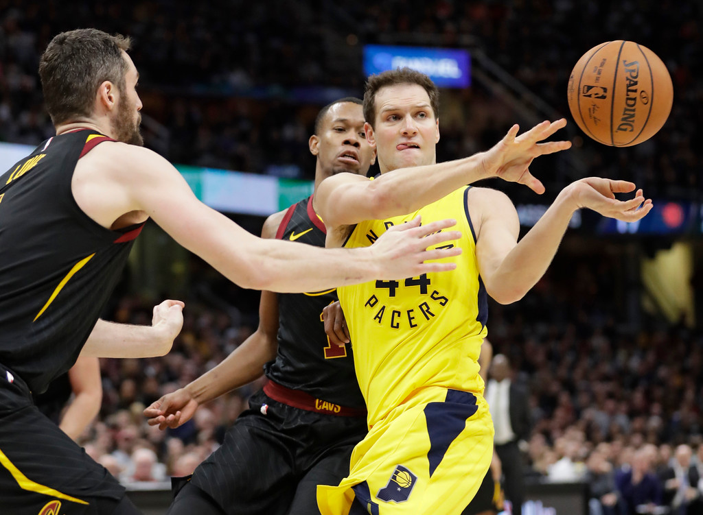 . Indiana Pacers\' Bojan Bogdanovic (44), from Croatia, passes against Cleveland Cavaliers\' Kevin Love (0) in the second half of Game 1 of an NBA basketball first-round playoff series, Sunday, April 15, 2018, in Cleveland. (AP Photo/Tony Dejak)