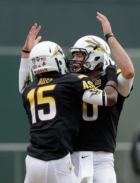 . Taylor Kelly #10 and Rashad Ross #15 of the Arizona State Sun Devils celebrate after Kelly threw a touchdown pass to Ross during the Kraft Fight Hunger Bowl against the Navy Midshipmen at AT&T Park on December 29, 2012 in San Francisco, California.  (Photo by Ezra Shaw/Getty Images)