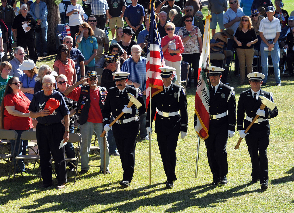 . Members of Redlands Fire Department Color Guard brings the flag forward during the Veterans Day cermony at Jennie Davis Park in Redlands, Monday, Nov. 11, 2013. (John Valenzuela/Staff Photographer)