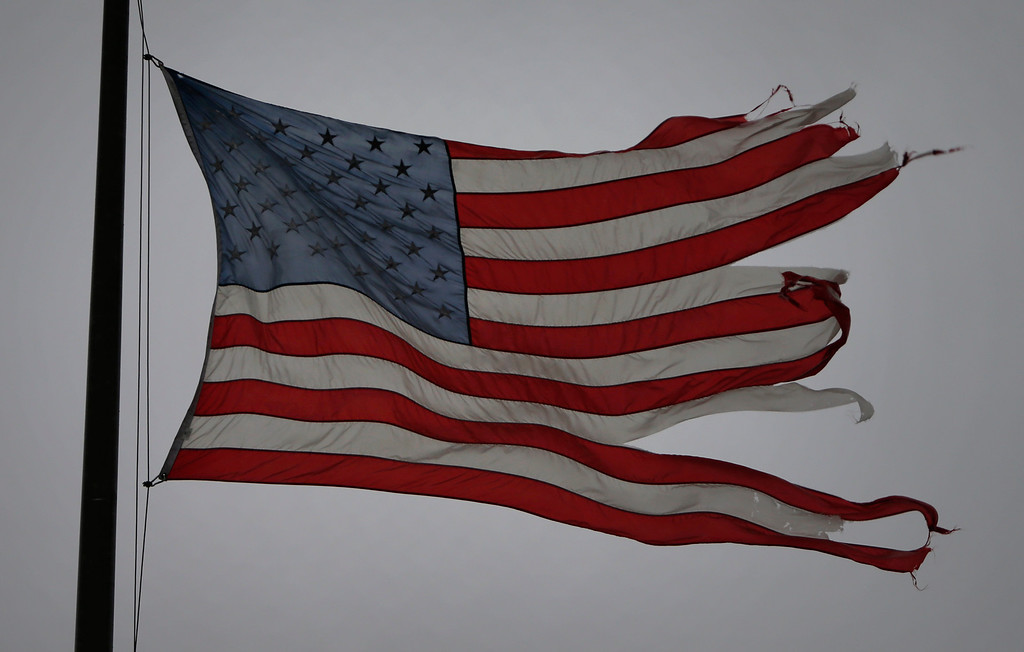 . A damaged American flag flaps in gale force winds on Duane Ave in Santa Clara, Calif., Thursday morning Dec. 11, 2014.(Karl Mondon/Bay Area News Group)