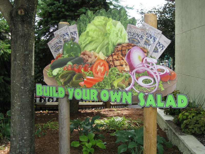 "The Pizza Ria ""Build Your Own Salad"" sign."