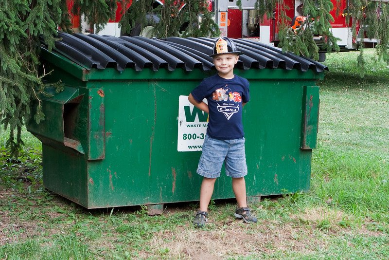 K.C. continues his fascination with garbage trucks and dumpsters.