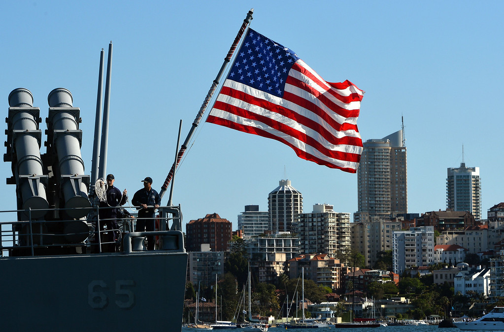 . A sailor looks at the Sydney skyline from a US navy warship, forward-deployed Ticonderoga-class cruiser USS Chosin (CG 65), at the Sydney Harbour on October 4, 2013. Ships from nations including China, Thailand, the US, Malaysia, France, Japan and former colonial power Britain passed through the heads into the famous harbour where they joined 16 tall ships from around the world in preparation for a ceremonial fleet review on October 5, 2013.  SAEED KHAN/AFP/Getty Images