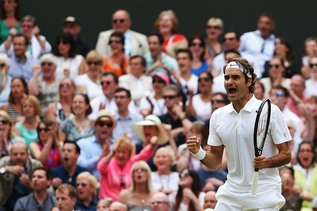 . Roger Federer of Switzerland celebrates during the Gentlemen\'s Singles Final match against Novak Djokovic of Serbia on day thirteen of the Wimbledon Lawn Tennis Championships at the All England Lawn Tennis and Croquet Club on July 6, 2014 in London, England.  (Photo by Matthew Stockman/Getty Images)