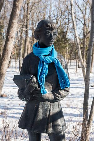 "DAVID LIPNOWSKI / WINNIPEG FREE PRESS  Even the sculptures need to bundle up, including ""School Girl"" Friday March10, 2017 at the Leo Mol Sculpture Garden at Assiniboine Park"