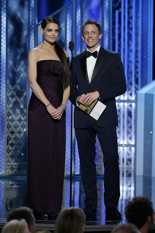 . BEVERLY HILLS, CA - JANUARY 11:  In this handout photo provided by NBCUniversal, Presenters Katie Holmes and Seth Meyers speak onstage during the 72nd Annual Golden Globe Awards at The Beverly Hilton Hotel on January 11, 2015 in Beverly Hills, California.  (Photo by Paul Drinkwater/NBCUniversal via Getty Images)