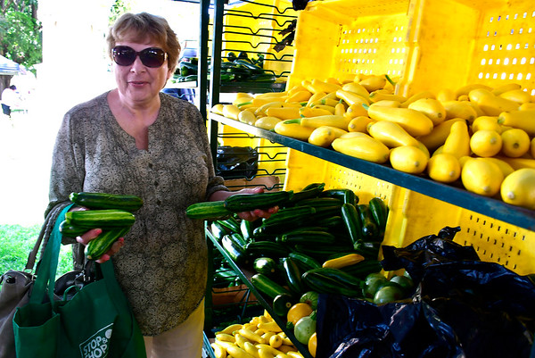 7/5/2019 Mike Orazzi | Staff Carol Selvaggi while shopping at the Southington Farmers' Market on the town green Friday.