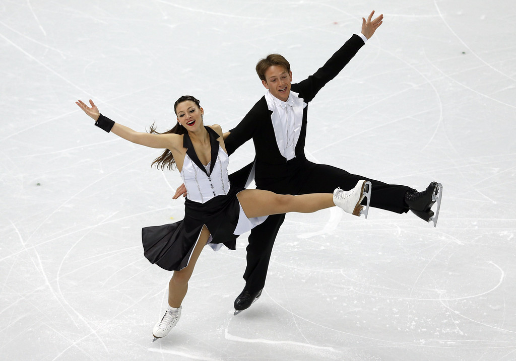 . Germany\'s Stefano Caruso and Germany\'s Tanja Kolbe perform in the Figure Skating Ice Dance Short Dance at the Iceberg Skating Palace during the Sochi Winter Olympics on February 16, 2014. ADRIAN DENNIS/AFP/Getty Images