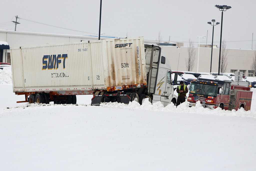 . A jack-knifed tractor-trailer blocks the Georgesville Road exit from I-270 southbound, Wednesday, March 6, 2013 in Columbus, Ohio. A late-winter storm dumped a half-foot or more of snow across much of Ohio on Wednesday, creating treacherous driving conditions for the morning rush hour.  (AP Photo/The Columbus Dispatch, Eamon Queeney)