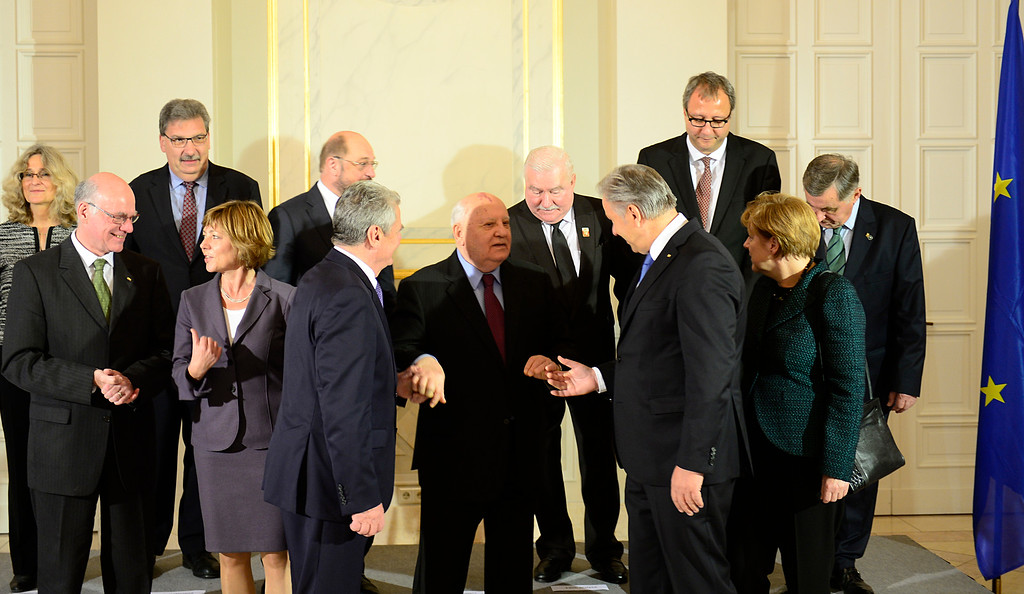 . Former Soviet leader Mikhail Gorbachev, center, is led by German President Joachim Gauck, 3rd left, and Berlin Mayor Klaus Wowereit, 2nd right, as they gather for a group photo with German Chancellor Angela Merkel, right, and former Polish President Lech Walesa, second row 3rd right, before a ceremony to mark the 25th anniversary of the fall of the Berlin Wall in Berlin, Germany, Sunday, Nov. 9, 2014. 25 years ago - on Nov. 9, 1989 - the East-German government lifted travel restrictions and thousands of East Berliners had pushed their way past perplexed border guards to celebrate freedom with their brethren in the West. (AP Photo/Robert Michael, Pool)