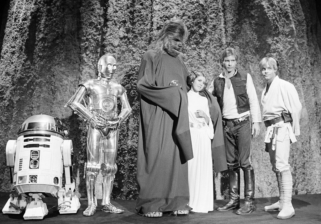 . Harrison Ford, as Han Solo of �Star Wars� with Carrie Fisher in the filming of the CBS-TV special �The Star Wars Holiday� Nov. 13, 1978. Ford says he leaves the singing in the special to Carrie, who is the daughter of Eddie Fisher and Debbie Reynolds. The film will also feature many special effects not seen on the original movie. (AP Photo/George Brich)