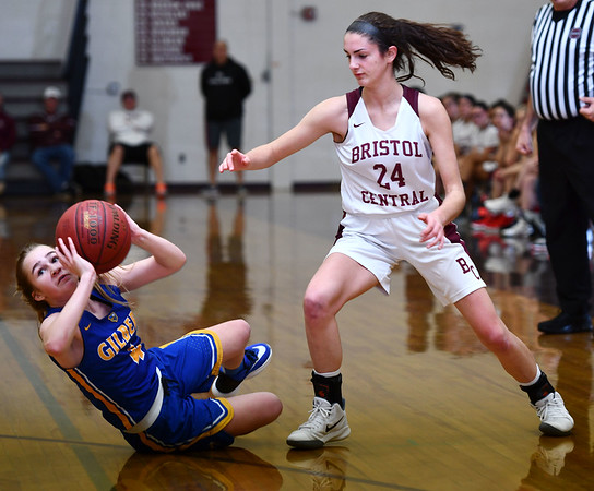 12/31/2019 MIke Orazzi | StaffrBristol Central's Sophia Torreso (24) and GIlbert's Kim McCarthy (4) during Tuesday's girls basketball game at Bristol Central in Bristol.