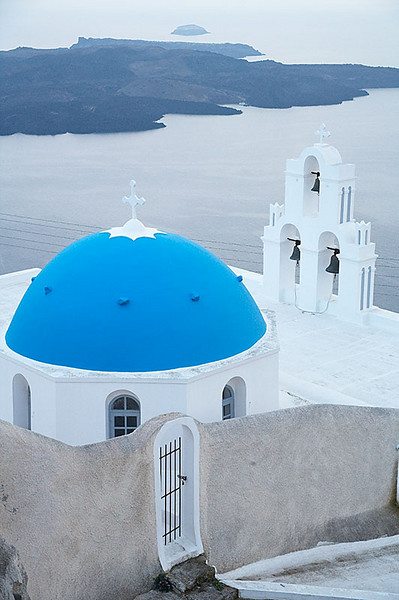 One of the famous blue domed churches built on the caldera of Santorini.