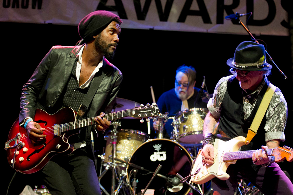 . In this Wednesday, March 13, 2013 photo, Gary Clark Jr, left, performs with Bill Carter at the Austin Music Awards ceremony at the Austin Music Hall in Austin, Texas. (AP Photo/Austin American-Statesman, Jay Janner)