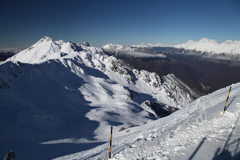 The view from the top! The Caucasus rise above the town of Krasnaya Polyana, Russia. This is taken from the top of Rosa Kultor Ski Area.
