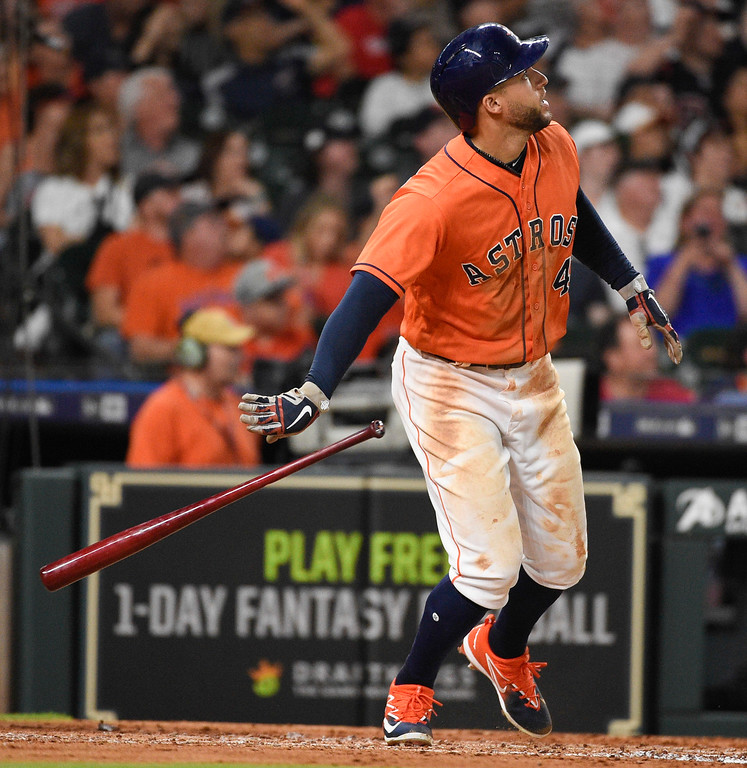 . Houston Astros\' George Springer watches his solo home run off Cleveland Indians starting pitcher Mike Clevinger during the third inning of a baseball game Friday, May 18, 2018, in Houston. (AP Photo/Eric Christian Smith)