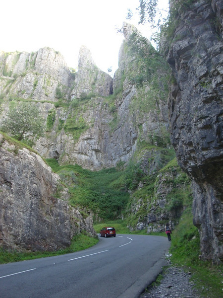 An hour south of Bristol is Cheddar Gorge. About 4 miles long and up to 138 m high, it's the largest in England. Britain's oldest complete skeleton was discovered here in 1903, dating from 7150 BC. DNA tests reveal some descendants of 'Cheddar Man' still live locally! It's also full of caves, in which Cheddar cheese was once stored before the pungent odour attracted too many rats!