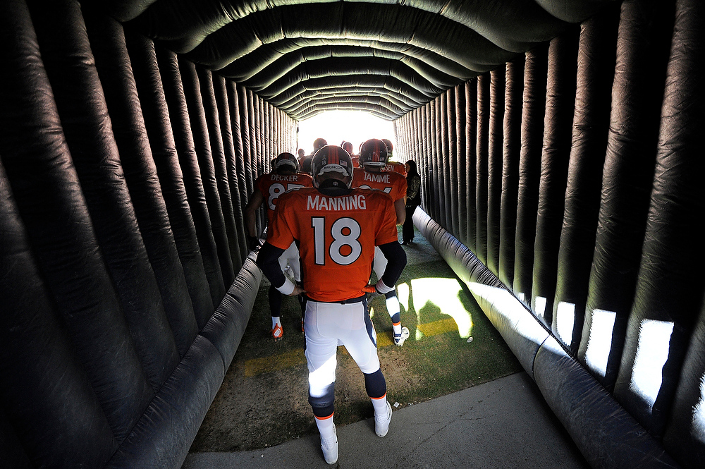. Denver Broncos quarterback Peyton Manning (18) waits for the team to exit the tunnel before heading on to the field prior to the game against the Cleveland Browns at Sports Authority Field on Sunday December 23, 2012. John Leyba, The Denver Post