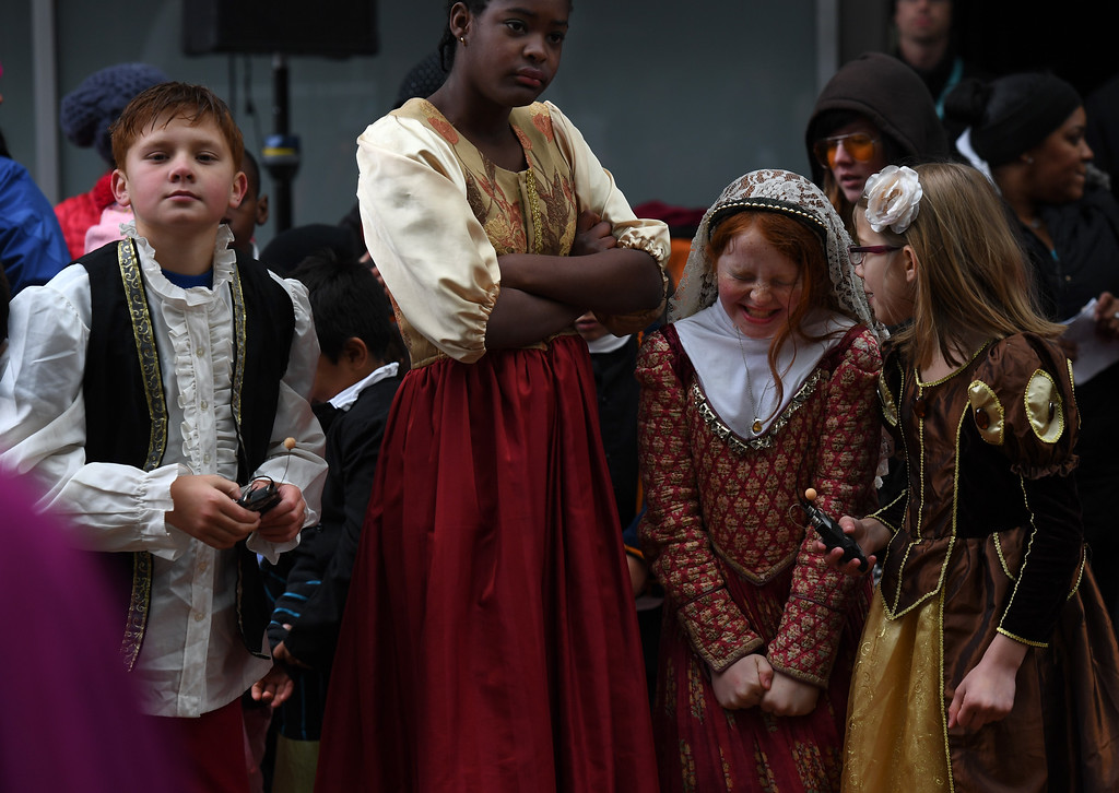 . Lowry Elementary School students from left to right, Seann Carlson, 9, Bintou Diane, 11, Chloe McPhee, 10, and Payden Coffey, 8, perform The Comedy of Errors with their fellow students.  (Photo by Kathryn Scott Osler/The Denver Post)