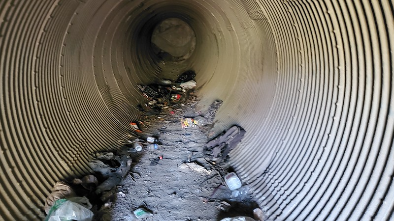 Homeless encampment in failed culvert