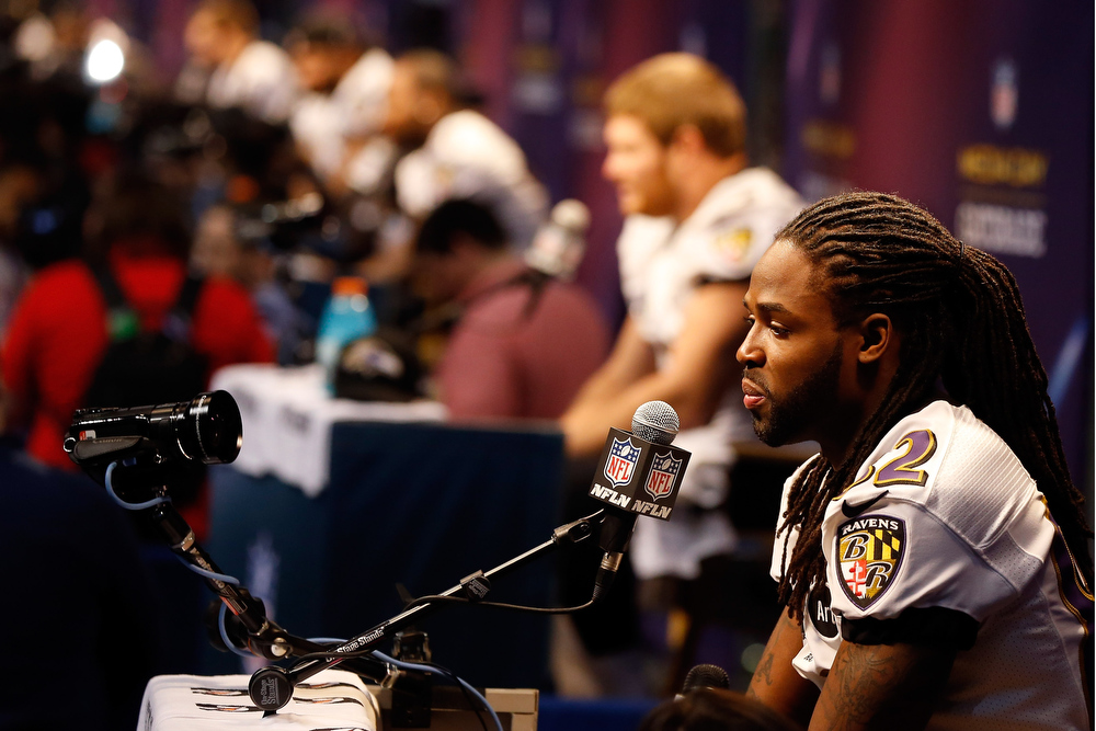 Description of . Torrey Smith #82 of the Baltimore Ravens answers questions from the media during Super Bowl XLVII Media Day ahead of Super Bowl XLVII at the Mercedes-Benz Superdome on January 29, 2013 in New Orleans, Louisiana. The San Francisco 49ers will take on the Baltimore Ravens on February 3, 2013 at the Mercedes-Benz Superdome.  (Photo by Scott Halleran/Getty Images)