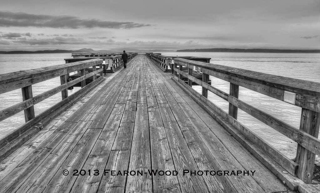 Lonely walk in the rain, Sidney pier, BC
