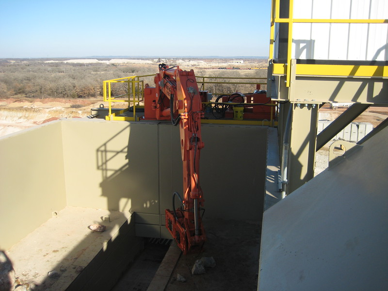 NPK B500 pedestal boom system with E208 hydraulic hammer-breaking rock in quarry (8).jpg