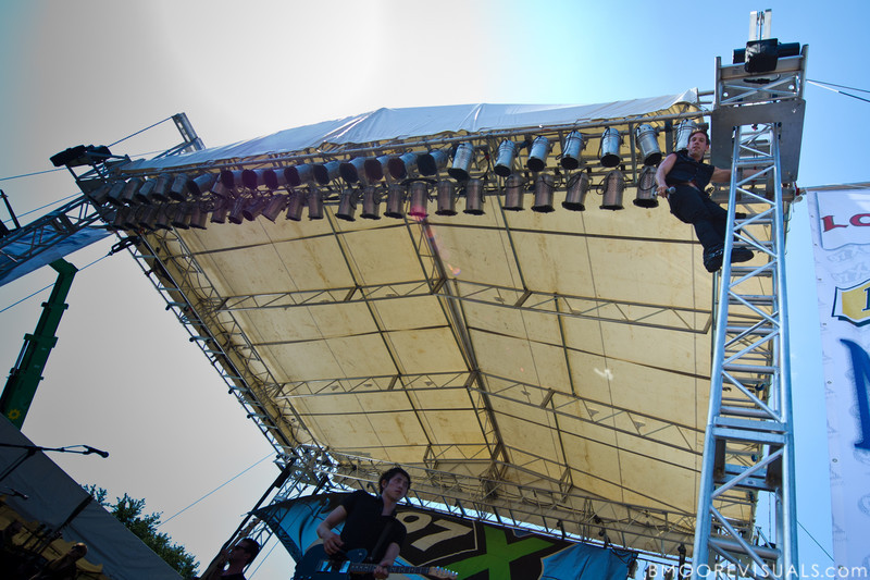 Mikel Jollett of The Airborne Toxic Event climbs the truss for a better view on May 28, 2011 at Vinoy Park in St. Petersburg, Florida
