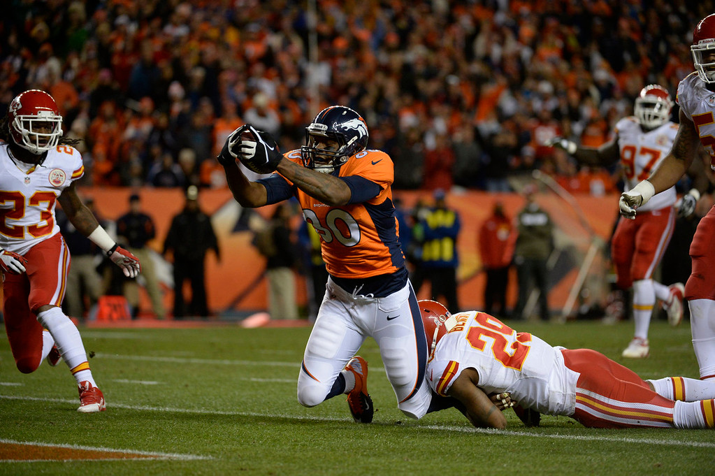 . Denver Broncos tight end Julius Thomas (80) makes a catch for a touchdown in the first quarter. The Denver Broncos take on the Kansas City Chiefs at Sports Authority Field at Mile High in Denver on November 17, 2013. (Photo by Tim Rasmussen/The Denver Post)