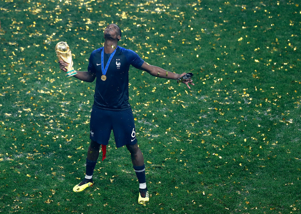 . France\'s Paul Pogba celebrates with the trophy after winning the final match between France and Croatia at the 2018 soccer World Cup in the Luzhniki Stadium in Moscow, Russia, Sunday, July 15, 2018. (AP Photo/Frank Augstein)
