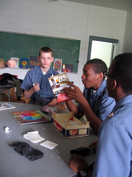 Cadet Matt Gaylord meets with the 8th Grade Art Class