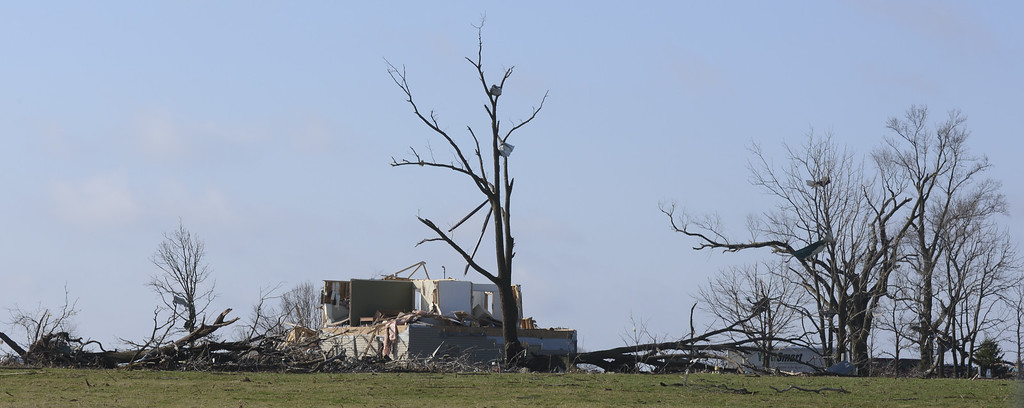. A farm is damaged as debris covers the ground in Dekalb County on Friday, April 10, 2015, following a tornado that hit the town of Fairdale, Ill., Thursday night killing one person. The National Weather Service says at least two tornadoes churned through six north-central Illinois counties. (AP Photo/Matt Marton)