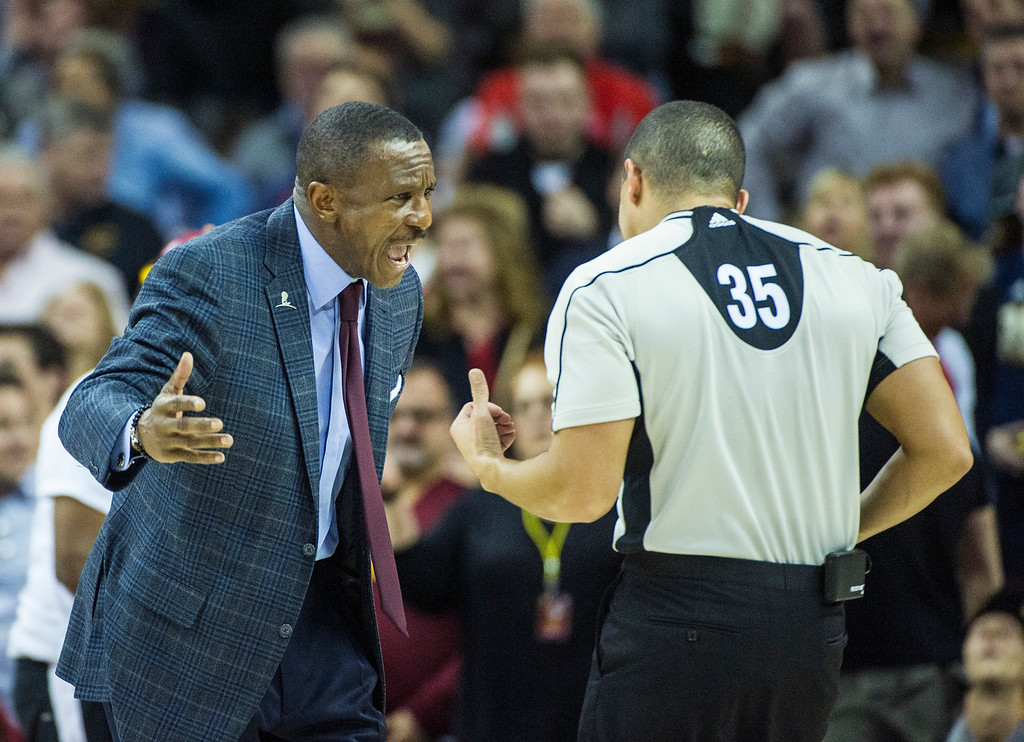. Toronto Raptors head coach Dwane Casey argues a call with referee Steve Anderson (35) during the second half of an NBA basketball game in Cleveland, Tuesday, Nov. 15, 2016. The Cavaliers won 121-117. (AP Photo/Phil Long)
