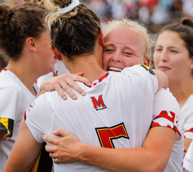 May 26, 2019: Maryland Jen Giles (5) and Carolin Steele (11) embrace each other after NCAA Womens Lacrosse Championship matchup between Boston College and University of Maryland in Baltimore. Photos by Chris Thompkins/Prince Georges Sentinel