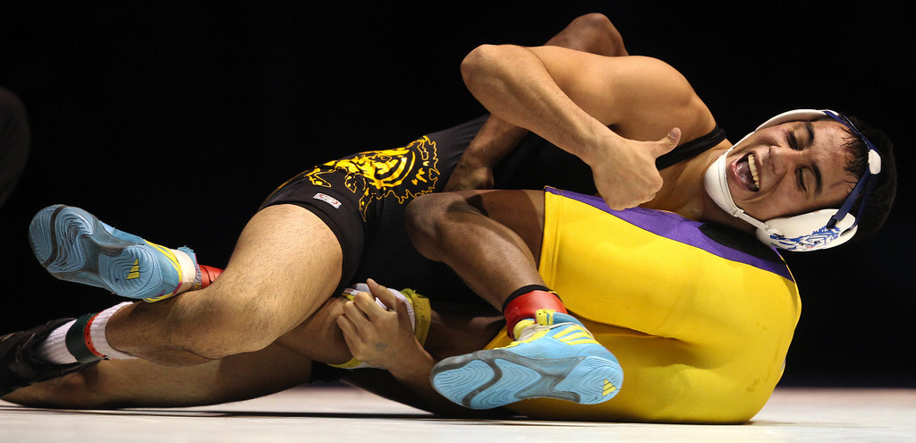 . Gilroy\'s Nikko Villareal takes the win against Riodan\'s Elijah Davis in the 138-pound championship match during the California Interscholastic Federation wrestling championships in Bakersfield, Calif., on Saturday, March 2, 2013. Villareal won the match 3-1. (Anda Chu/Staff)